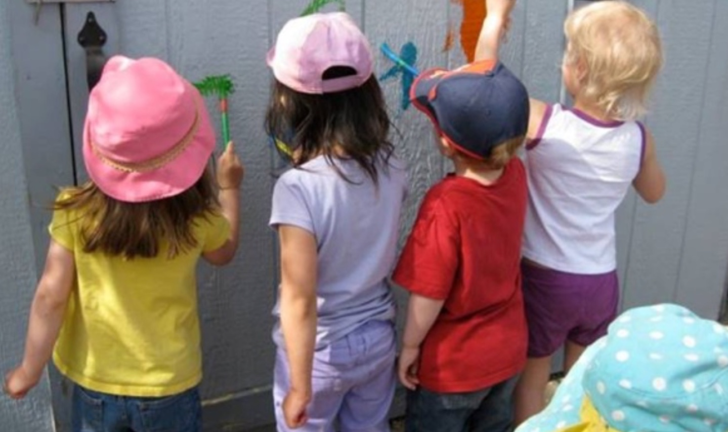 Children painting on a wall
