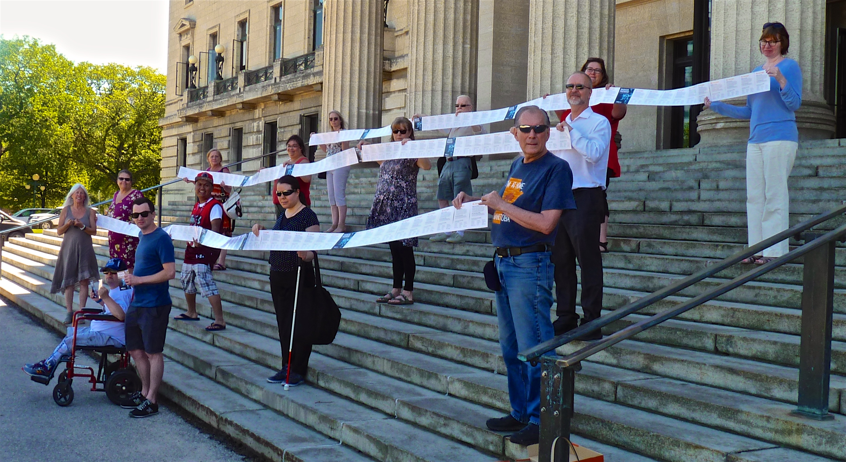 Supports hold ribbons of post cards on steps of Legislative Building